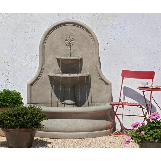 A wall fountain in a Verde finish.