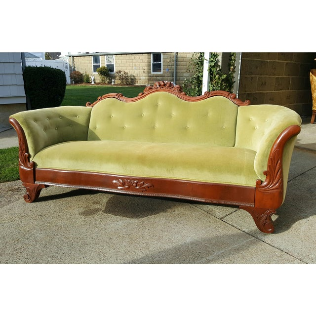 Beautiful antique carved wood sofa. Green velvet upholstery with button details. Upholstery in great condition. Stunning...
