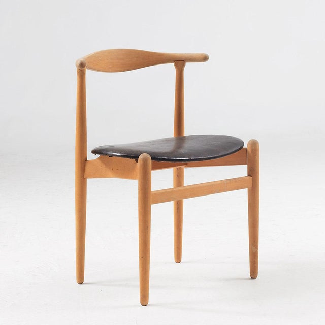 Hans Wegner, dining chairs model FH 1934, designed in Denmark in 1949. Solid wooden beech frame with curved backrest....