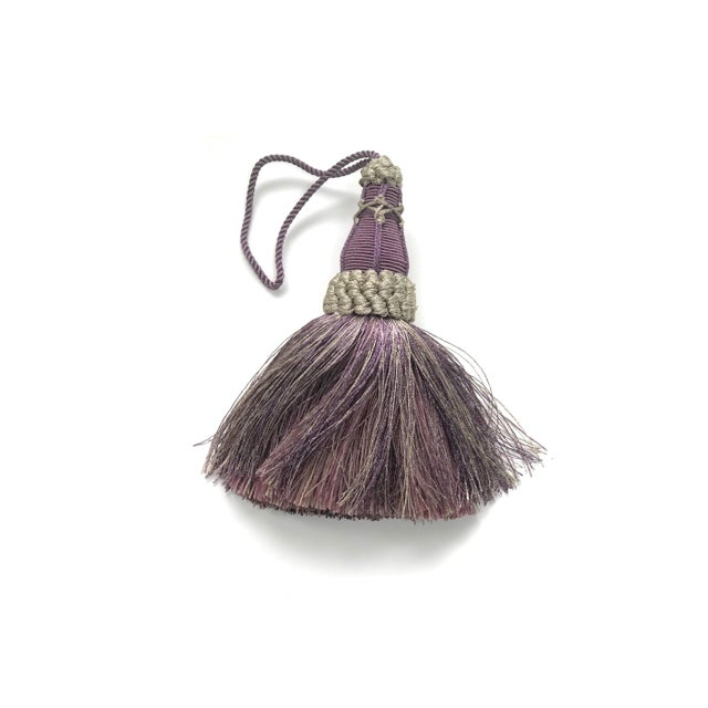 Handmade amethyst and grey colored key tassel with looped ruche, twisted cord and full skirt. Skirt has a blend of colors...