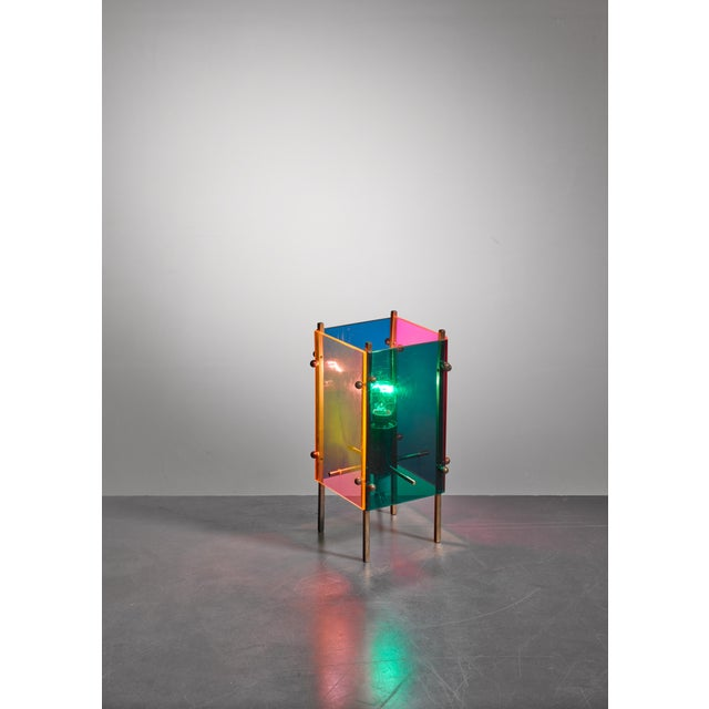 A table lamp attributed to Angelo Lelli for Arredoluce, made of blue, green, orange and yellow plexiglass panels on a...