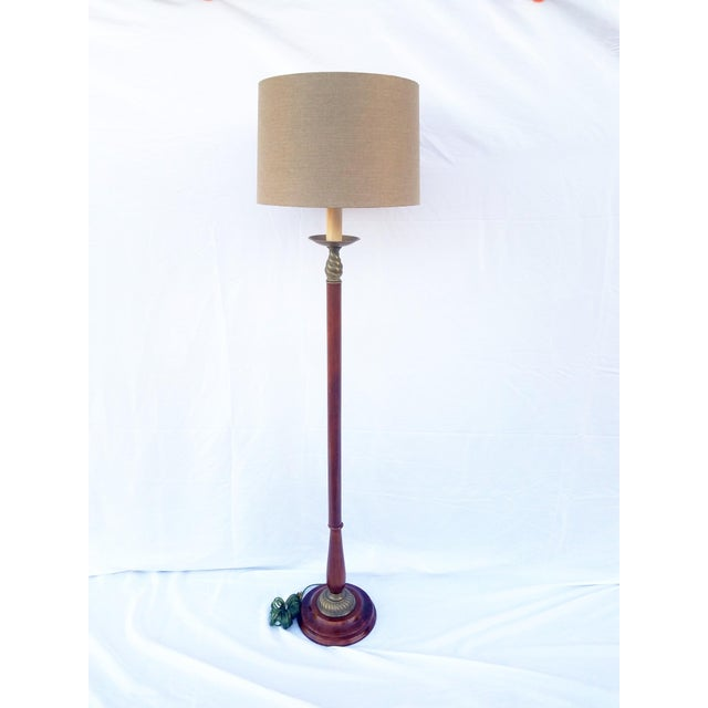 This lamp has a stepped mahogany base with the most beautiful grain. It has antiqued solid brass decorative trim top and...