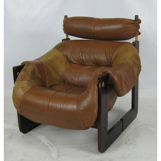 Rosewood Framed Lounge chair with beautifully patinated Leather seat by Percival Lafer.