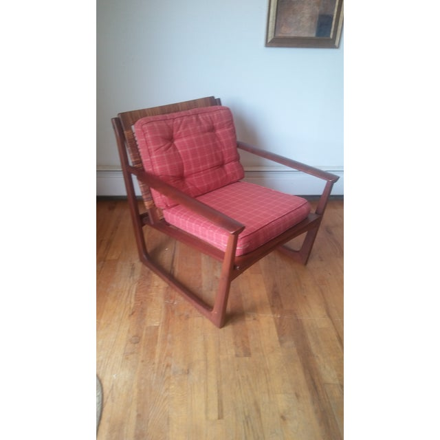Danish mid-century modern lounge chair has a cane back by Selig. Teak, made in Denmark. Has 2 labels. Circa 1960s. Few...