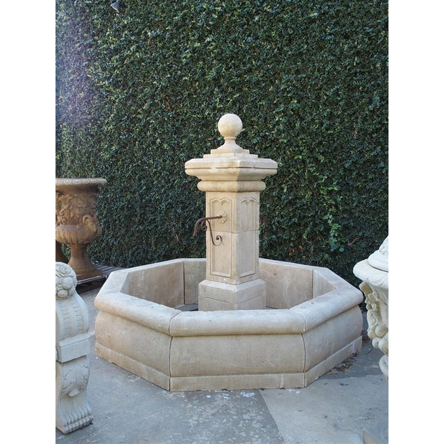 This beautiful French center fountain from Provence has been hand carved and distressed out of Estaillade limestone. The...