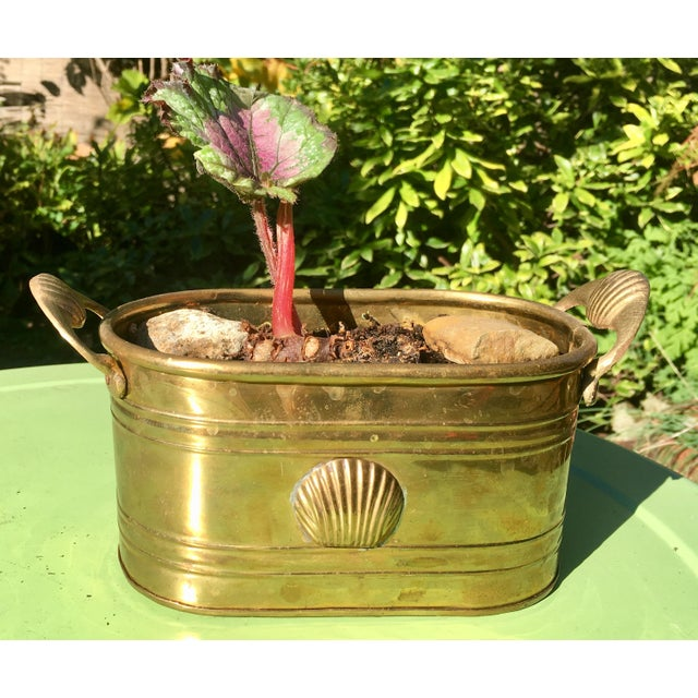 Classic home decor ~ this awesome vintage brass planter features a shell detail at front and handles on either side of the...