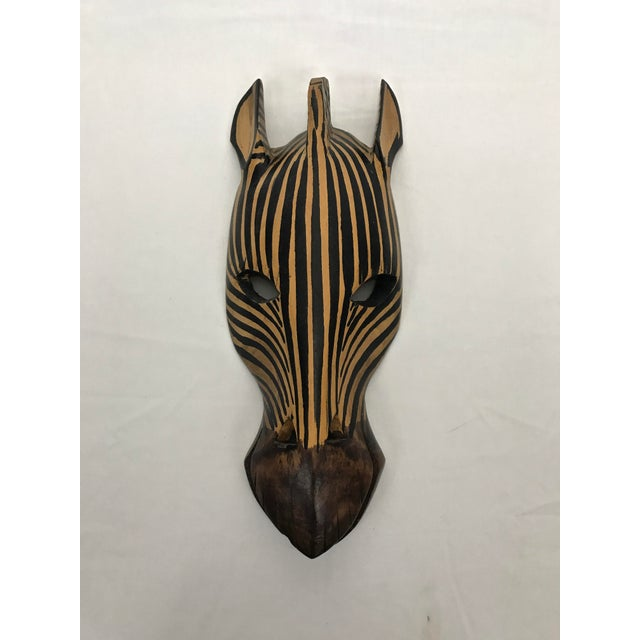 Hand-carved and hand-painted wooden Zebra mask. Original sticker still attached: Hand carved, Made in Kenya. Hanging...