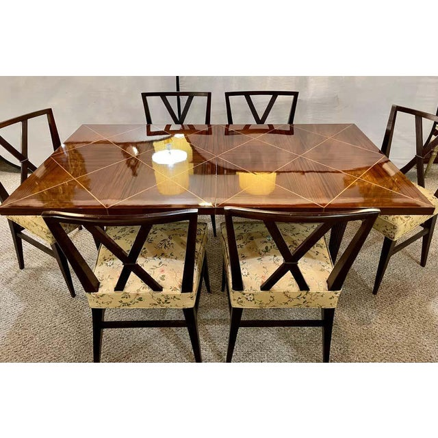 A Tommi Parzinger Originals Dining Table Fully Refinished with Two Leaves that measure 17.25 inches each. The sleek...