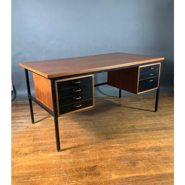 A great combination of light teakwood top/case with seven drawers fronted with black lacquer and simple squared brass...
