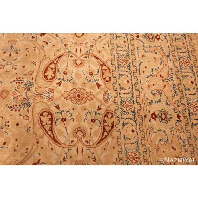 Breathtaking Ivory Background Antique Tabriz Haji Jalili Persian Rug 49347, Country of Origin / Rug Type: Persian Rug,...