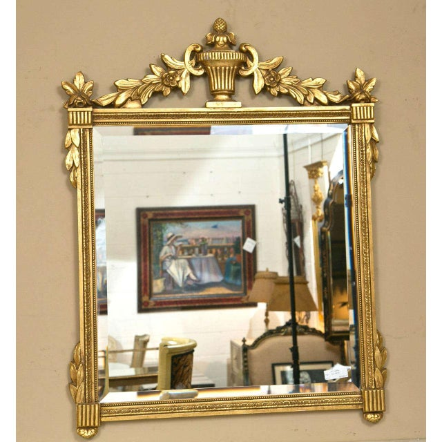 Pair of Neoclassical style giltwood mirrors, the square looking glass surmounted in the giltwood frame, the top decorated...