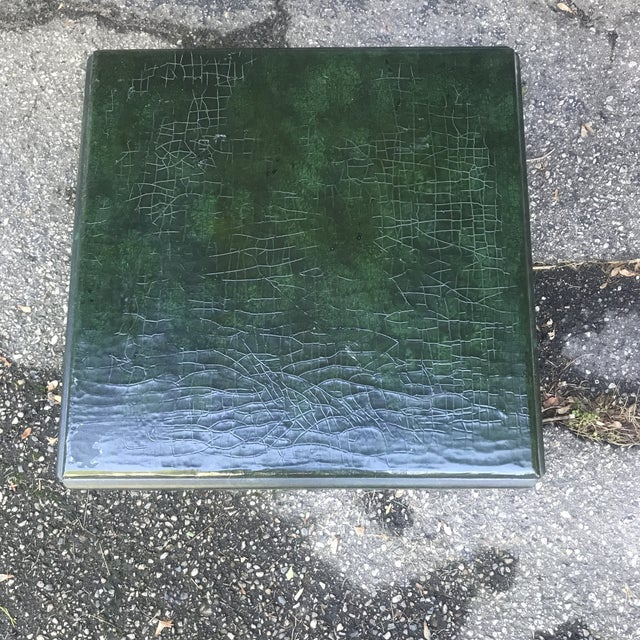 Quality accent table by Baker Furniture. Finished with a crackled green glaze. Solid and well built. Cube shaped with full...