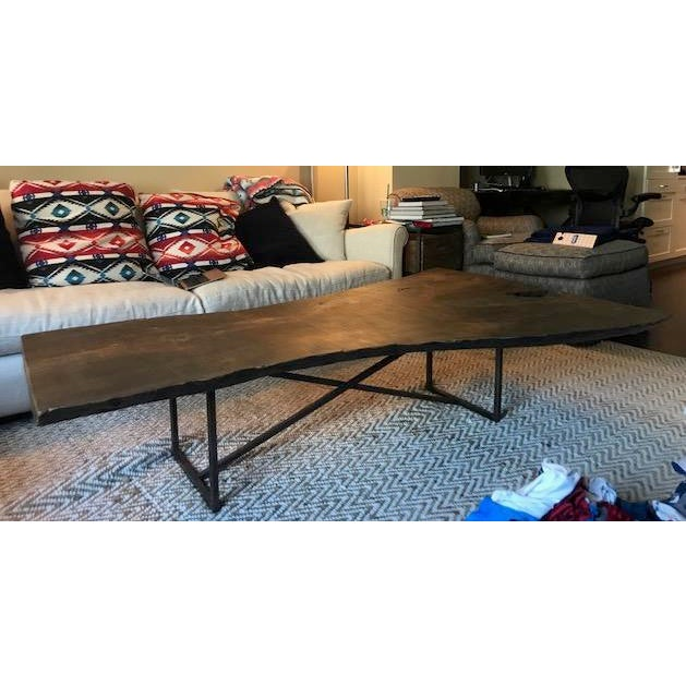 Beautiful reclaimed wood coffee table with solid iron base. Stunning