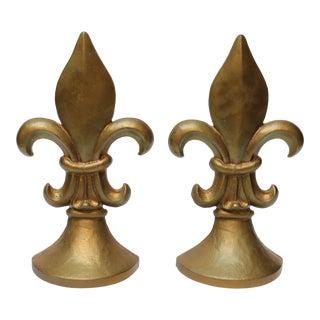 Pair of Vintage Gilded Cast Iron Fleur De Lys Sculptures For Sale