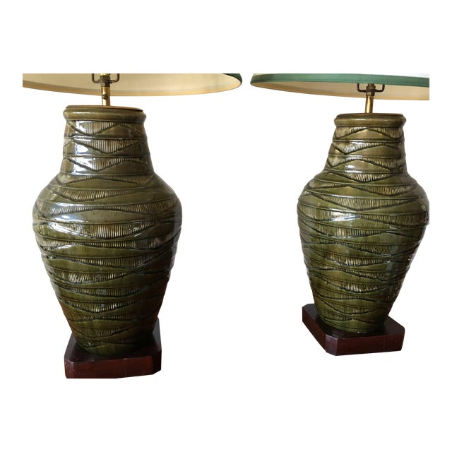 """A pair of large-scale green Thai Celadon-marked lamps. Ceramic/porcelain bases measure approx. 18"""" H, 10"""" D, with shades..."""