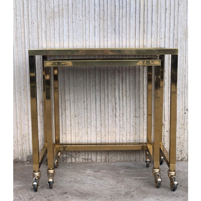 Nesting Tables Italian Design 1970 in Brass With Smoked Glass and Wheels - a Pair For Sale In Miami - Image 6 of 11
