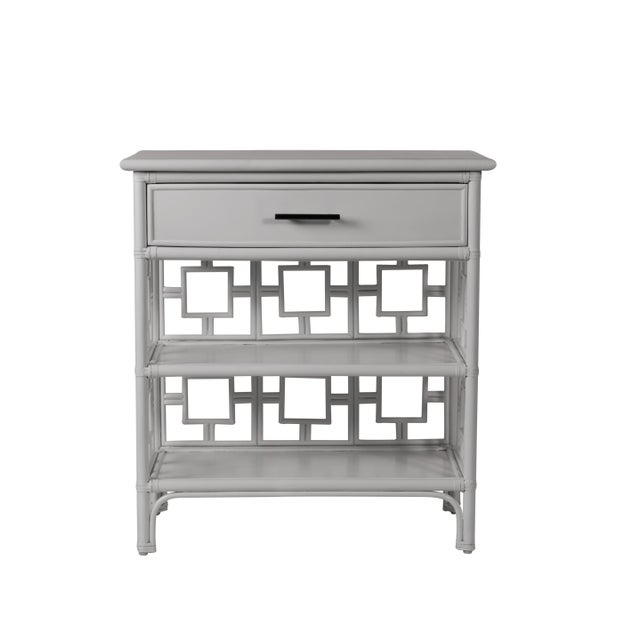 Classically styled, this end table features a Rattan frame with rawhide bindings. The intricate rattan detail is hand...