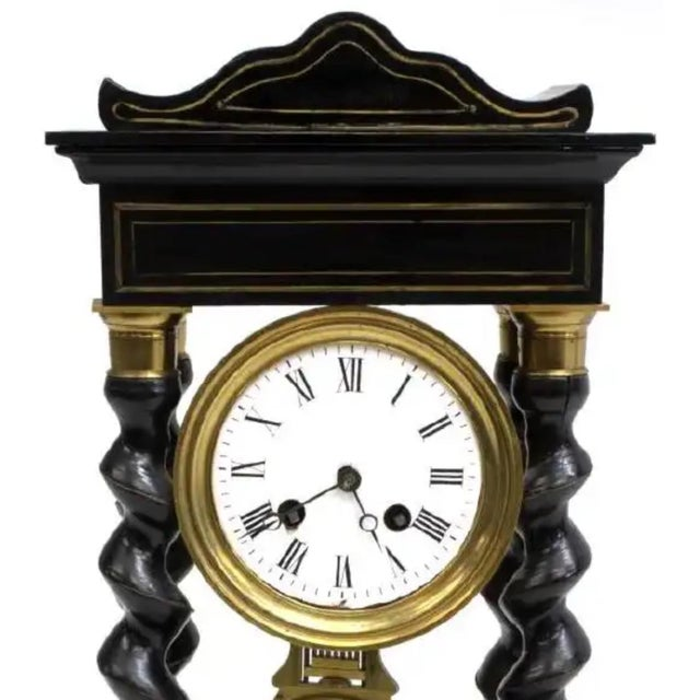 French Napoleon III Period portico clock, mid 19th c., having ebonized case, with gilt metal string inlay, circular white...