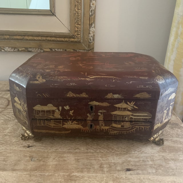 Antique Chinese Red Layered Sewing Box With Drawer. One drawer, opens at top, multiple compartments, sewing pieces (pin...