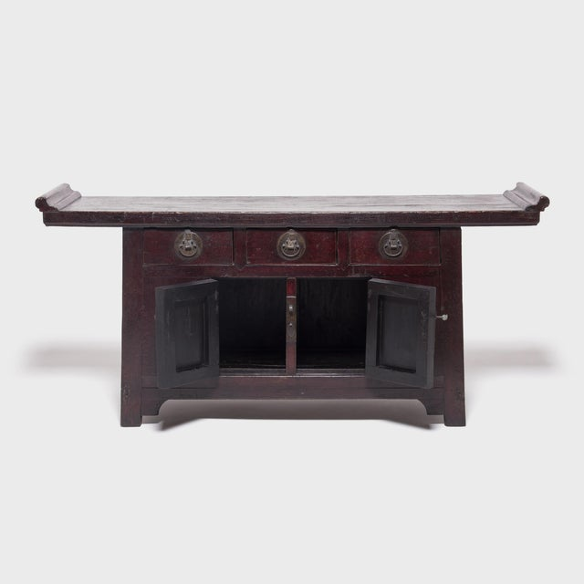 Hand-crafted brass hardware punctuates this Qing-dynasty coffer's richly lacquered surface with moon-shaped locks, hinge...