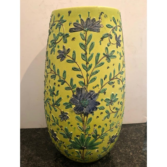 """A wonderful 1940's tall yellow majolica with blue flowers vase from Italy. Signed on the bottom """"made in Italy""""."""