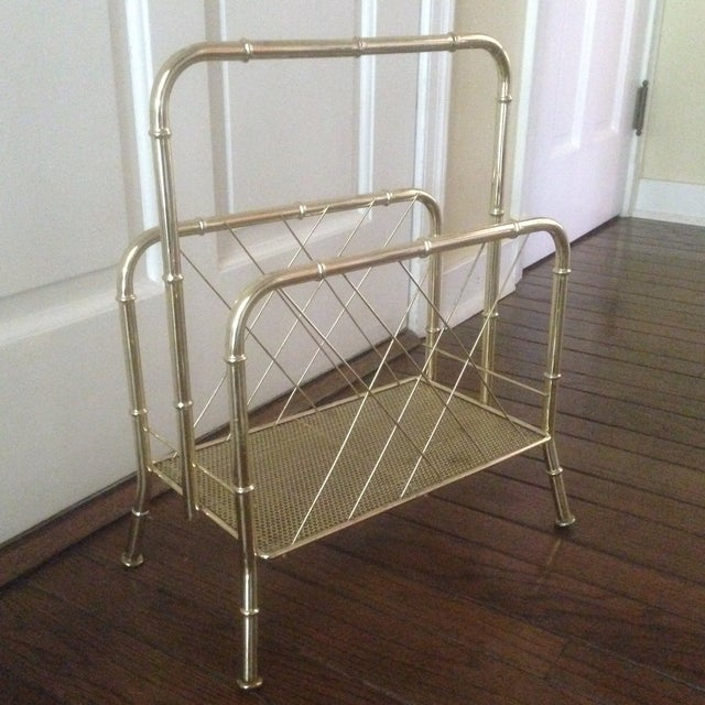 """A vintage, faux bamboo magazine rack in gold tone metal. The depth of the basket is 8.25"""", height from base to top is 18""""...."""