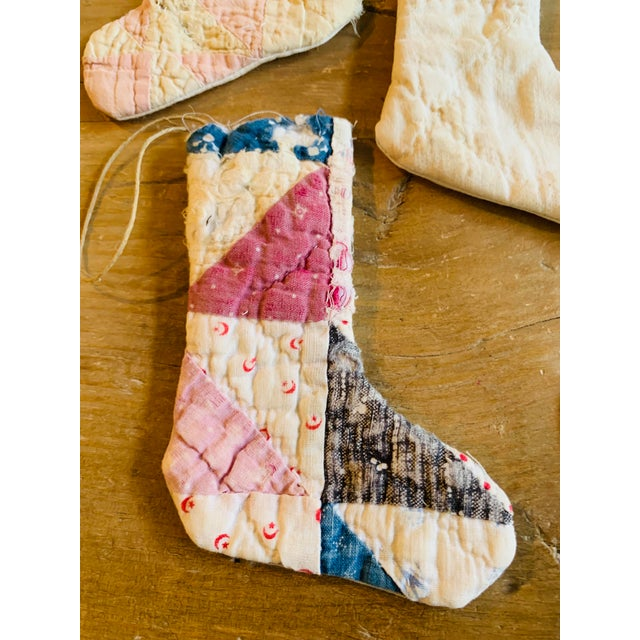 Adorable handmade Christmas stocking ornaments made from disassembled vintage quilts and men's dress shirts! Cute and eco...
