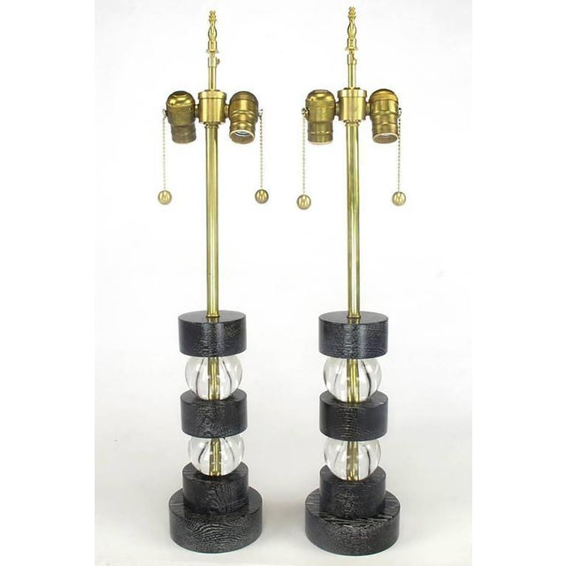 Excellent pair of black lacquered and cerused oak crystal ball segmented table lamps with brass double sockets. Great size...
