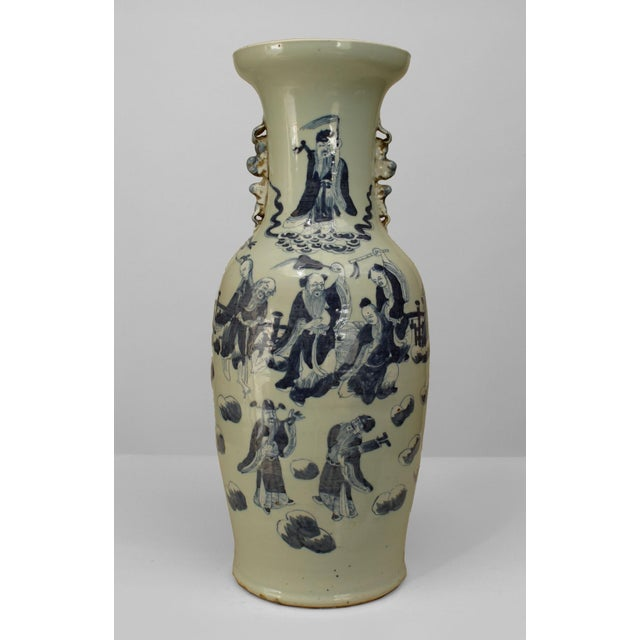 Asian Chinese (20th Cent) celadon porcelain vase decorated with classical Chinese figures with small side handles