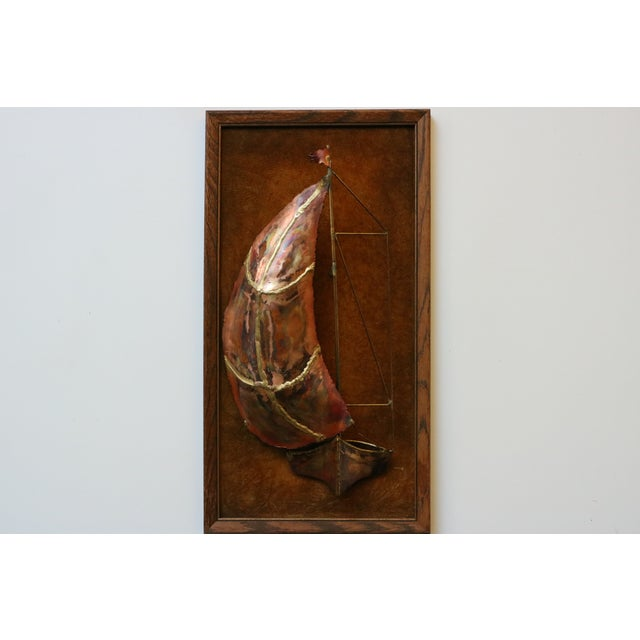 Vintage framed metal sailboat sculpture with a beautiful, coppery hue. Set against cognac-colored velour, this wood framed...