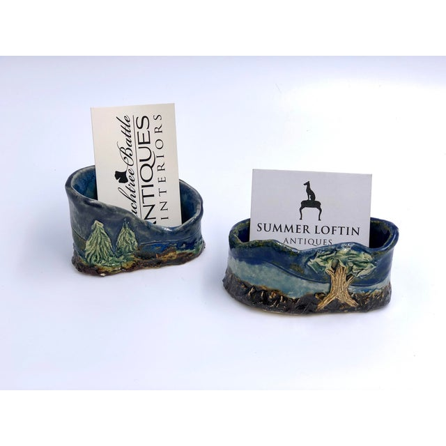 Jazz up your office with these one-of-a-kind artisan made business card holders! The friendly pair is made of ceramic in...