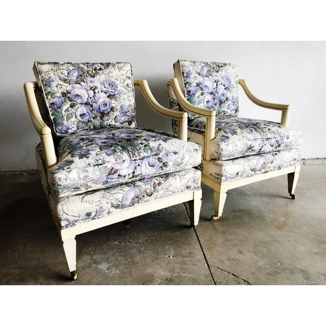 Stunning, high-quality Baker carved wood arm lunge club chair with vintage violet floral wrapped upholstery frame. This...