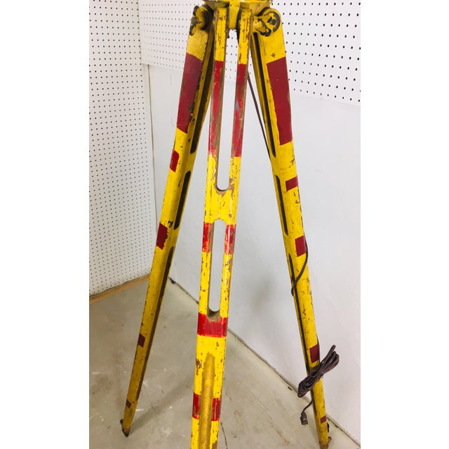 This is a vintage surveyors tripod. This tripod has been converted into a floor lamp and comes complete with a linen...