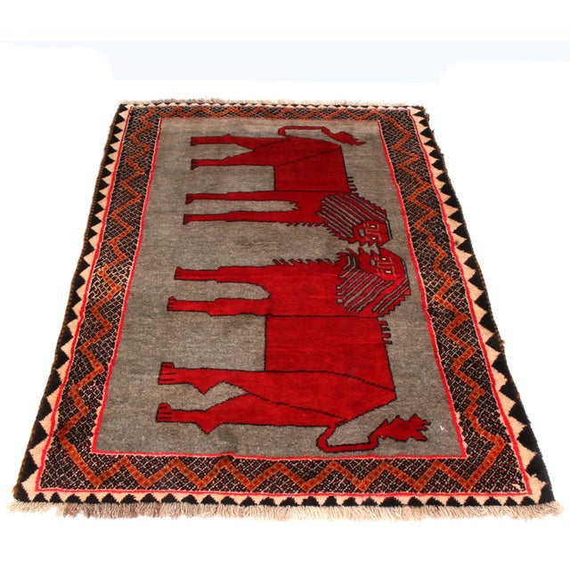 Hand knotted in wool pile originating from Persia between 1950-1960, this vintage Gabbeh Persian rug is unique among the...