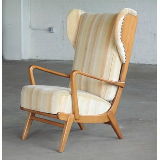 Danish Midcentury Wingback Lounge Chair With Exposed Sides Preview