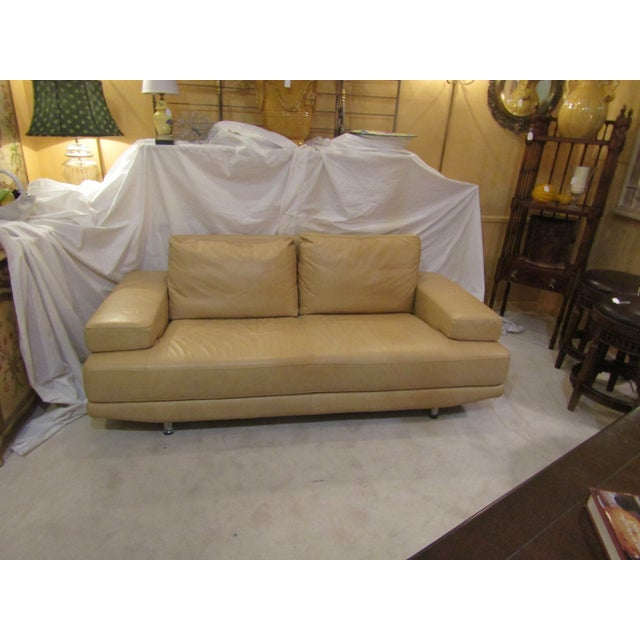 The sofa is wrapped in top grain genuine Italian leather all around in a creamy butterscotch color. Soft padded wide arms...