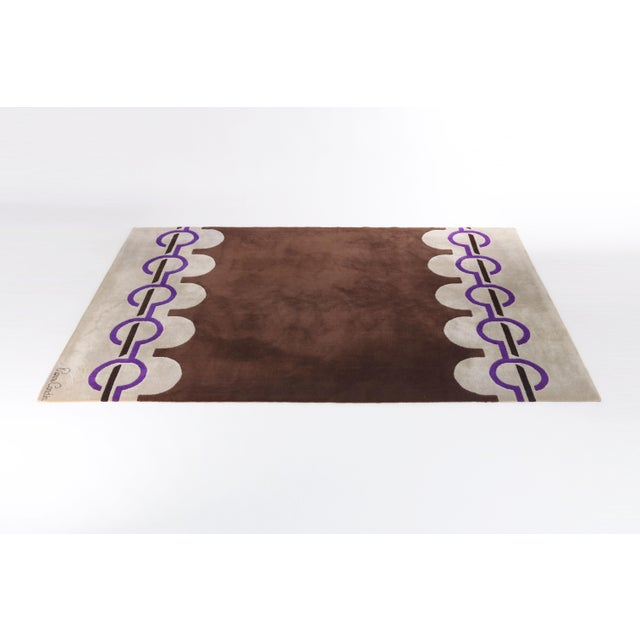 Here is a wonderfully stylish area rug designed by Pierre Cardin. Brown, purple and taupe wool combined in Cardin's...