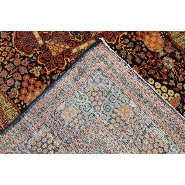 "Hand made antique Persian Dabir Kashan rug in colourful wool with ""grapes"" design. The rug is from the end of 19th century..."