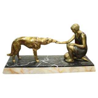 French Art Deco Patinated Metal Sculpture of a Deco Lady and Her Dog, C1940's For Sale