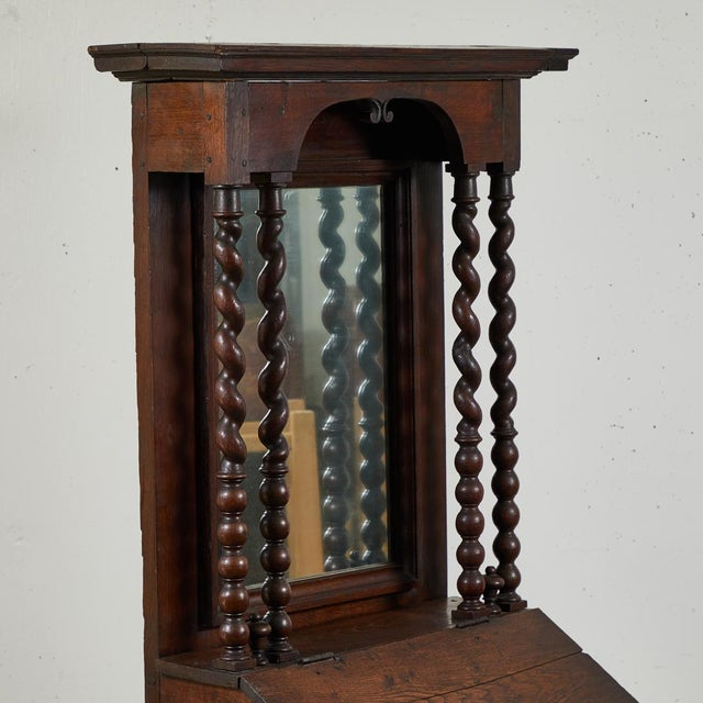 Early 18th century French petite secretaries or fall front bureau cabinet with projecting cornice and arched front...
