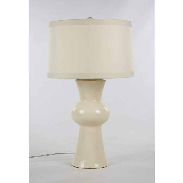 With a timeless look, this modern porcelain table lamp by Gordon will fit seamlessly into any living space. This piece...
