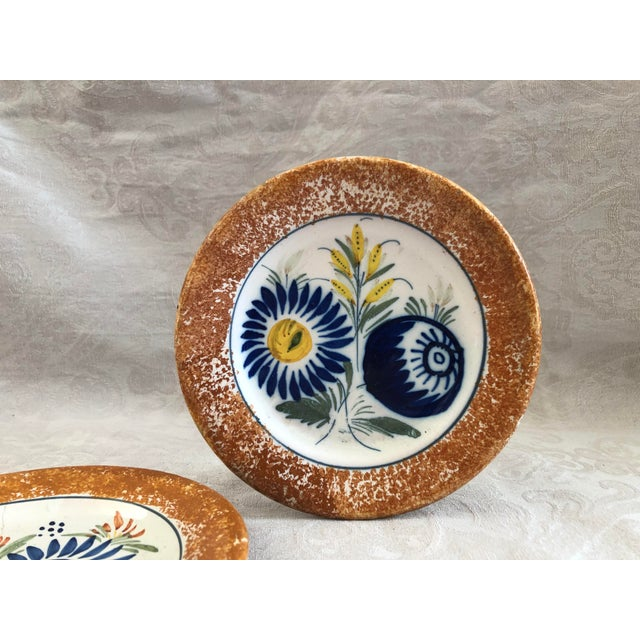 These circa 1930s Henriot Quimper French pottery plates have an unusual orange sponge-painted border and lovely hand-...