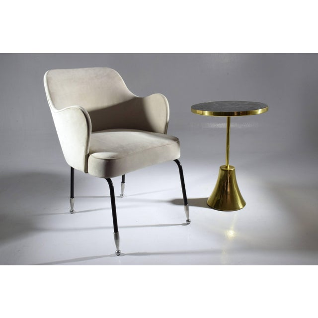 Contemporary handcrafted guéridon side table composed of a solid brass structure and designed with an intricate black...