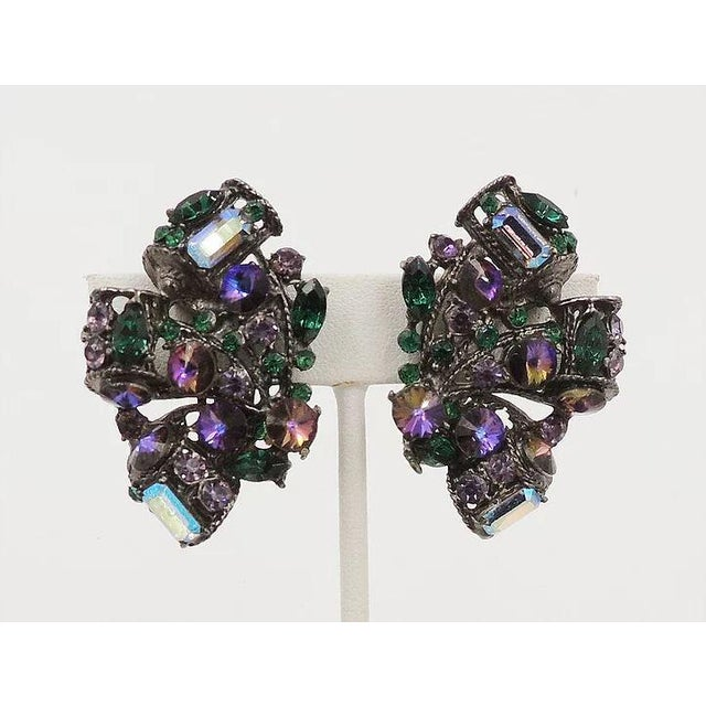 1980s japanned metal purple rivolis, green marquise and round rhinestones and light purple aurora borealis clip back...