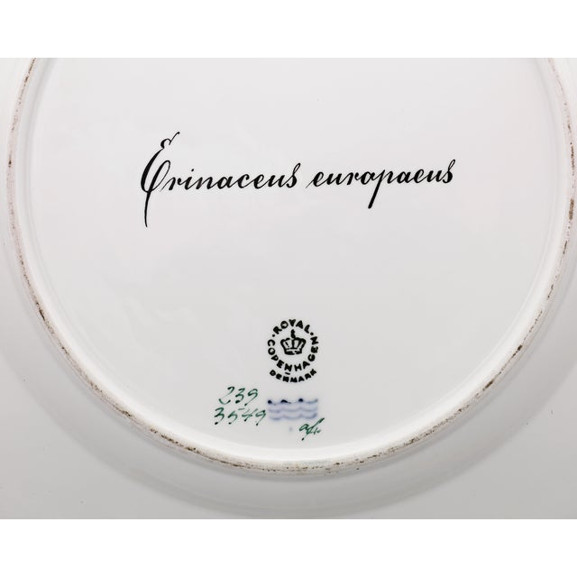 This porcelain dinner plate by Royal Copenhagen is part of the exceptionally rare Flora Danica Games Series. While most...