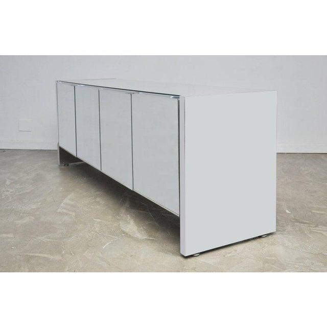 Ello mirrored sideboard with chrome slab sides, pulls, and detailing. Excellent condition.