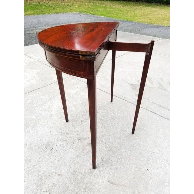 Beautiful patina on this antique rosewood Hepplewhite demilune flip top card table.Nice inlay details all around the sides...