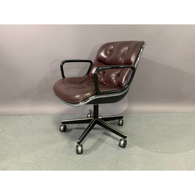 Pair of Executive Chairs designed by Charles Pollock in 1965 for Knoll International in cordovan leather. This comfortable...