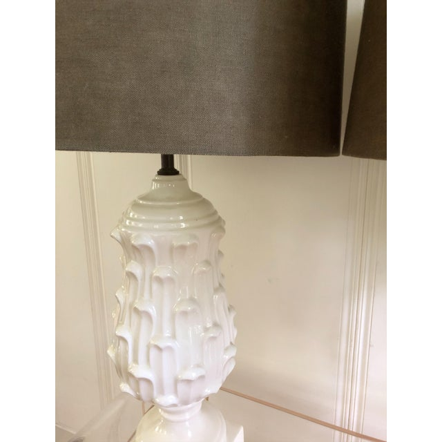 """Fabulous pair of white ceramic artichoke lamps in Hollywood Regency style, with olive green linen drum shades (10"""" high x..."""