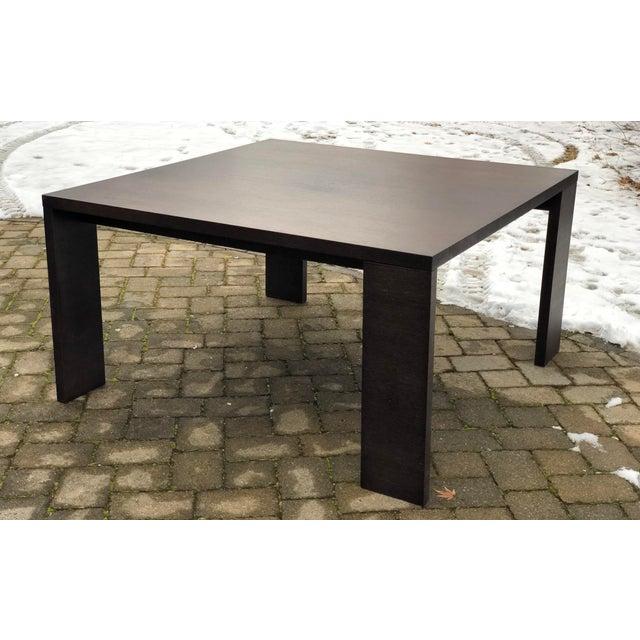 B&B Italia Maxalto 'Apta' dining table designed by Antonio Citterio in 1999. Asymmetrically positioned legs mark the look...